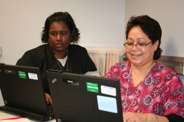 Screaming Eagle Medical Home licensed practical nurses Marlo Daniel (left) and Maria Sanchez say they enjoy forming bonds with their patients at Fort Campbell, Ky.