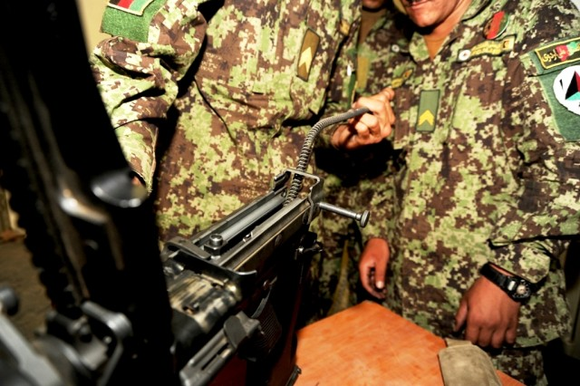 Soldiers from the 207th Afghan National Army repair  M-240s at Camp Zafar, Herat, Afghanistan, April 26. The 207th Afghan National Army Corps received their first-issued weapons repair kits from coalition forces and can now perform maintenance their own weapons.