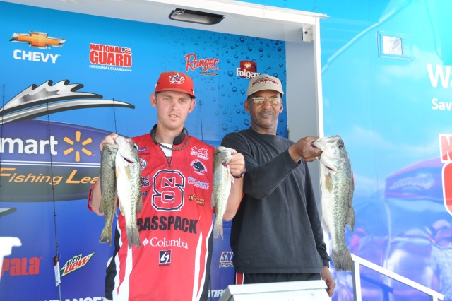 """Sgt. 1st Class Willie Bartley Jr., U.S. Army Forces Command G1, and bass angler Stanton McDuffie, proudly display their """"keepers"""" from the 6th Annual Warriors on the Water Military Appreciation Bass Fishing Tournament, April 29, 2011, at Jordan Lake, N.C.  McDuffie, a member of the N.C. State University Bass Fishing Team was one of 150 volunteer professional and recreational bass anglers from across the United States who took an equal number of joint service members out for a day of competitive fishing.  In strict accordance with the tournament's """"catch and release"""" protocol, the fish were safely returned to the lake, helping to ensure the healthy survival of the species.  Note: The N.C. creel limit for bass is five, all of which must measure a minimum of 14 inches, from nose to tail."""