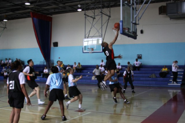 The 19th Expeditionary Sustainment Command team plays against the United States Army Garrison-Daegu team in the basketball semi-finals during the 2011 KATUSA Friendship Week at Camp Walker April 21.