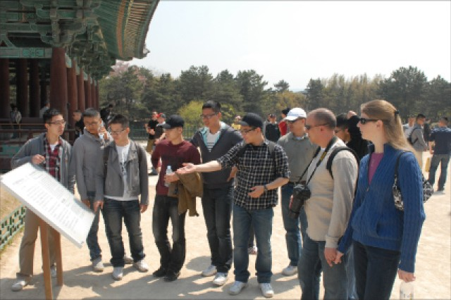 Cpl. Lee Dae-hyun, 19th Expeditionary Sustainment Command G-6, explains the history behind Anapji, an artifical pond that was used by the king of Silla to hold receptions. Soldiers from the Daegu and Waegwan areas toured the traditional city of Gyeongju April 20.