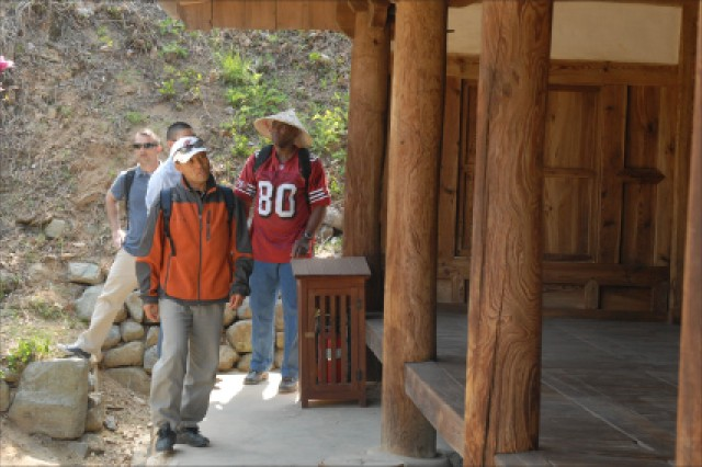 19th Expeditionary Sustainment Command Soldiers and officers walk through YangDong Village.