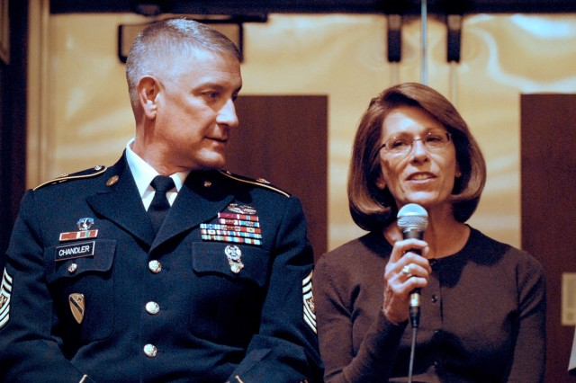 Sergeant Major of the Army Raymond F. Chandler III and his wife, Jeanne, address an audience of family support professionals during a senior enlisted advisor town hall meeting at the 2011 Family Resilience Conference in Chicago, April 28, 2011.