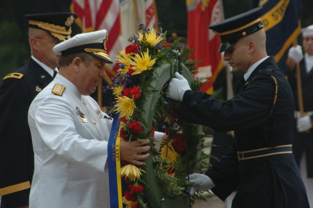 Staff Sgt. Jonathan Brisiel (right), Assistant Sergeant of the Guard, assists a dignitary in laying a wreath during an Armed Forces Full Honor Wreath Ceremony at the Tomb of the Unknown Soldier, Arlington National Cemetery, Va. Brisiel is now a career counselor for The Old Guard and recently reenlisted his brother who is currently a Tomb Sentinel at the tomb of the Unknown Soldier. (U.S. Army Photo)