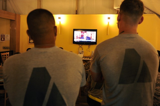 U.S. Servicemembers watch on television as President Barack Obama talks about the details of the death of 9/11 mastermind Osama Bin Laden inside the USO at Kandahar Airfield, Afghanistan, May 2, 2011.