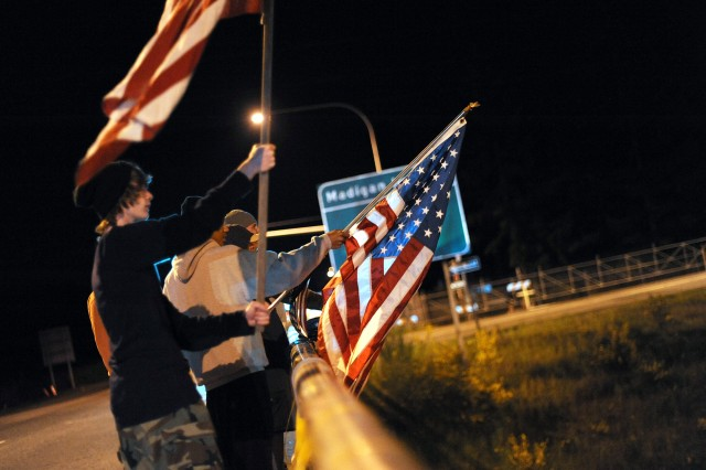 People with American flags gather on 'Freedom Bridge' above Interstate 5 outside the Madigan Gate at Joint Base Lewis-McChord May 1, 2011 in celebration of the death of Al Qaeda leader Osama bin Laden. (Ingrid Barrentine/Northwest Guardian)