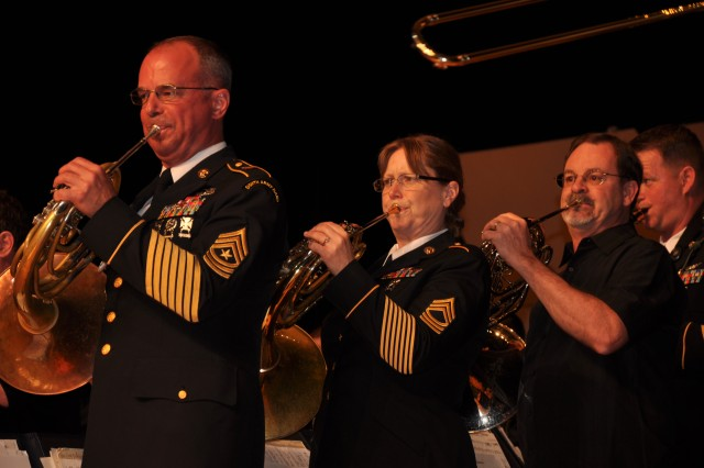 Army Ground Forces Band veteran French horn players (left to right) Sgt. Maj. Robert Stagg, now the sergeant major for the Eighth Army Band in Korea; Master Sgt. Jean Van Effen, who will soon be on her way to Korea to become the first sergeant for the 2nd Infantry Division's band; and retired Master Sgt. Glen Moore give it their all for their old band.  The band will leave Fort McPherson, Ga., in June for its new home at Fort Bragg, N.C.
