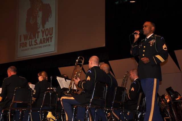 """The Army Ground Forces Band's vocalist Staff Sgt. Stanmore Hinds sings a very moving rendition of """"We Were There,"""" accompanied by a slideshow that took the audience on a journey of historical Army events during the band\'s alumni reunion concert at McEachern High School Performing Arts Center."""