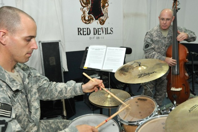 BASRAH, Iraq - Sgt. Charles Fricker, a percussionist and 39-year-old native of Philadelphia, Pa., and Staff Sgt. Maurice Kelley, a bassist and 40-year-old native of Sedalia, Mo., practice some songs for the 36th Infantry Division Band's jazz ensemble. The two Soldiers were recently notified they had been chosen to receive prestigious awards from the School of Music, the military occupational skill school for band members of all branches of service.