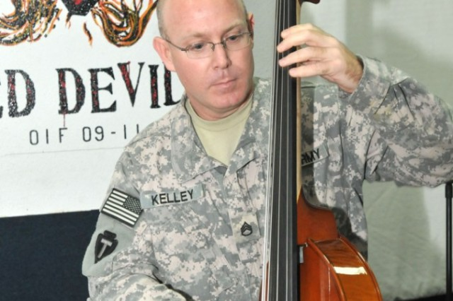BASRAH, Iraq - Staff Sgt. Maurice Kelley, a bassist with the 36th Infantry Division Band and a 40-year-old native of Sedalia, Mo., plays some jazz music on his upright bass. The 10-year veteran of the Army Reserve and National Guard was recently chosen as the Army Reserve Component Senior Non-Commissioned Officer of the Year for 2010.