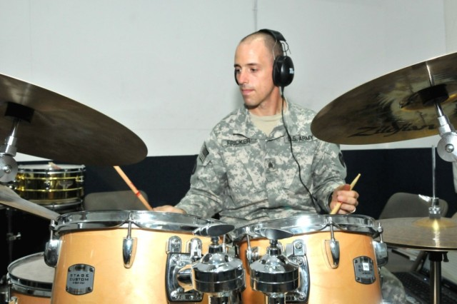 BASRAH, Iraq - Sgt. Charles Fricker, a percussionist with the 36th Infantry Division Band and a 39-year-old native of Philadelphia, Pa., practices beats for his role as the drummer in the division rock band. The 14-year veteran of the Army Reserve and National Guard was one of 12 recipients of the first Col. Finley R. Hamilton Military Outstanding Musician Award, which acknowledges enlisted musicians from each branch of service in the U.S. Military Forces who show exceptional qualities in military leadership and music.