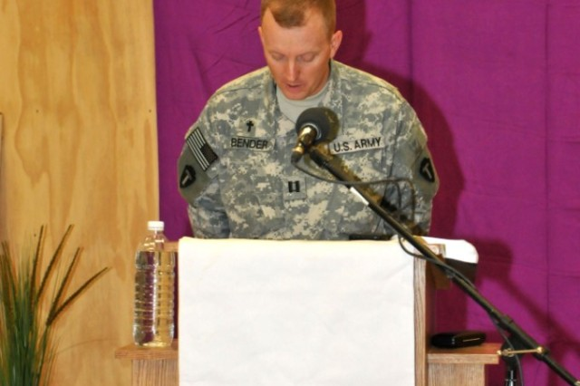 BASRAH, Iraq - Capt. Harold B. Bender, deputy division chaplain for U.S. Division = South and the 36th Infantry Division, leads a prayer during Easter service at the Contingency Operating Base Basra Chapel, April 24.