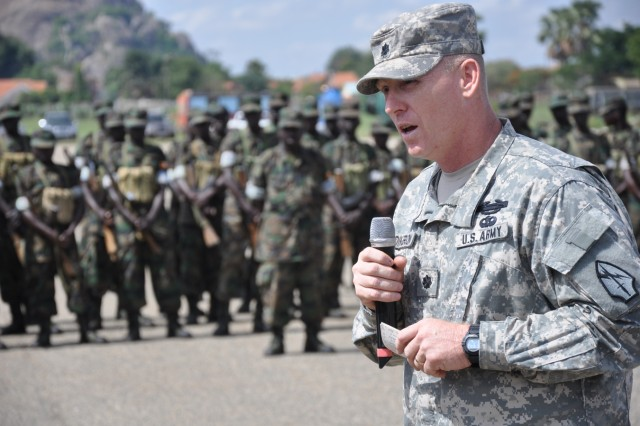 Lt. Col. Jeffrey Dickerson, exercise deputy director and commander of Task Force Atlas, speaks during the Atlas Drop 11 opening ceremony at Soroti Airfield, Uganda, April 13, 2011.