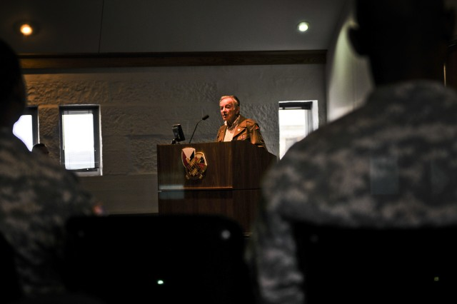 Walter Reed, born Werner Rindsberg in Würzberg, Germany, recounts the story of his family's persecution by Nazi Germany and his subsequent flight to the United States as a teen. He returned years later to a war-torn Europe as an American Soldier in 1944 serving at the front lines as an interrogator in the 95th Infantry Division as part of Gen. George S. Patton's renowned Third Army. Reed was the guest speaker for the Army Sustainment Command's Holocaust Days of Remembrance Observance, May 3, in Rock Island Arsenal's Black Hawk Conference Room. (Photo by Sgt. 1st Class Sean Riley, ASC Public Affairs)