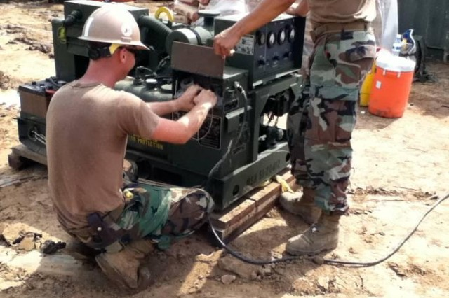 Petty Officer 2nd Lopez makes repairs on the generator. Lopez is assigned to the Naval Mobile Construction Battalion 133. NMCB 133 constructs new three-room schoolhouse and renovates health clinic at Kampong Speu, Cambodia. Additional task include investigating possible repair of inoperable wells in area as time, budget and conditions permit as part of Exercise Angkor Sentinel. Angkor Sentinel is a continuation of ongoing U.S. Army efforts co-sponsored by the U.S. Military and Royal Cambodian Army. The exercise for will include planning and executing a battalion level command post exercise, constructing engineer civic action projects and executing a medical civic action project. The exercise will also provide the venue for assistance and training to the Cambodian military, and support U.S. and Cambodian security objectives