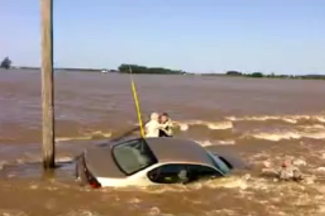 POPLAR BLUFF, Mo. -- Two Missouri National Guard Citizen-Soldiers conduct a daring rescue of a 93-year-old woman from her flooded car on the swollen Black River May 3, 2011.