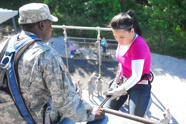 Linh Archuleta prepares to rappel down Victory Tower under the watchful eye of Sgt. 1st Class Dennis Lance, 165th Infantry Brigade, during the brigade's John and Jane Wayne Day event Saturday.