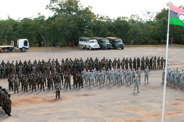 Malawi Defence Force and U.S. Soldiers stand at attention during the opening ceremony of MEDREACH 11 at the Kamuzu Barracks, Lilongwe, Malawi, May 3, 2011.
