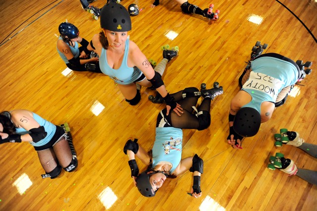 Above: The Bombshell Betties stretch prior to the Battle of Derby Hill roller derby bout against the GI Janes April 30 at AFC Arena on JBLM.