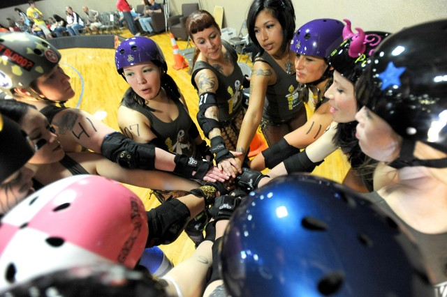 GI Janes skaters rally prior to the Battle of Derby Hill roller derby bout against Bombshell Betties April 30 at AFC Arena on JBLM.