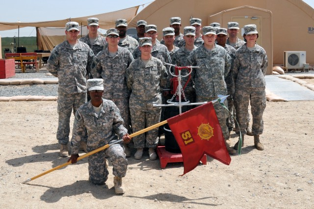"The Maintenance section of the 51st Transportation Company headquartered in Mannheim, Germany, stands around to the coveted ""Motor Pool of the Month"" trophy presented by the 197th Fires Brigade's Safety and Environmental sections on May 5, 2011 at Camp Arifjan, Kuwait."
