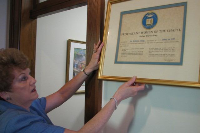 Donna Craven, director of religious education in the Garrison Chaplain's Office, handles the PWOC original charter, which is located in the Fort McPherson Post Chapel. Chartered Jan. 1, 1960, the Fort McPherson PWOC was one of the oldest PWOC groups in the U.S. Over its 51 year history, the group was visited by many notable people, including Chick-Fil-A chairman and founder S. Truett Cathy, former Atlanta Falcons linebacker Greg Brezina and Dr. Martin Luther King Sr. among others.