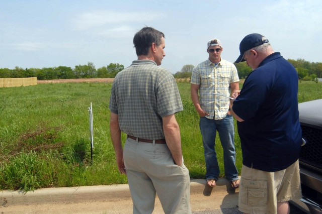 From left, Renaissance Builders Inc. workers Tod Yarbrough and Eric Hayden accompany Homes for Our Veterans liaison Larry Gill on a visit to the Madison lot where a house will be built for Cpl. Jeffery Williams.