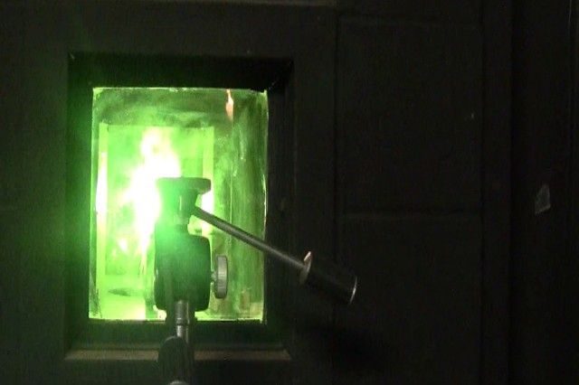 Because of its inertness, chemists have viewed boron carbide dimly as a source for pyrotechnic material. But the glow in this test chamber window means its prospects are brightening.