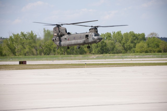 A CH-47 Chinook helicopter makes a landing on Fort Riley's Marshall Army Airfield, May 3. This and dozens more helicopters from the Combat Aviation Brigade, 1st Infantry Division have made their return to Fort Riley this week after a year in Iraq. (U.S. Army photo by Sgt. Roland Hale, CAB, 1st Inf. Div. PAO)