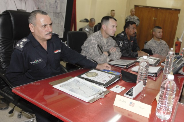CONTINGENCY OPERATING BASE ADDER, Iraq - Lt. Col. Robert Wright, the commander for 2nd Battalion, 82nd Field Artillery Regiment, 3rd Advise and Assist Brigade, 1st Cavalry Division sits with local police officials during a route security conference at Contingency Operating Base Adder April 28.