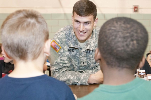 First Lt. Clay Woody talks to kindergartners during lunchtime at Wamego's Central Elementary School, May 5. Soldiers of Fort Riley's 2nd General Support Aviation Battalion, 1st Aviation Regiment, Combat Aviation Brigade, 1st Infantry Division have visited the school since January as part of an Adopt-a-School program. (U.S. Army photo by Sgt. Roland Hale, CAB, 1st Inf. Div. PAO)
