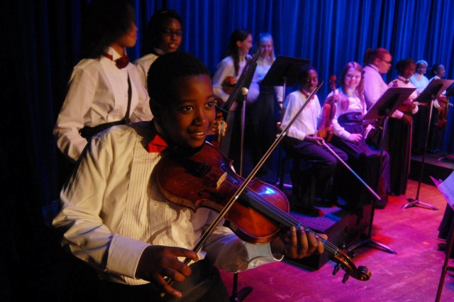 Jacquez Harris warms up on the violin for the AAA orchestra concert.