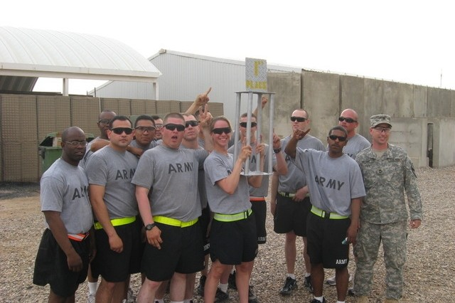 Contingency Operating Base Basrah, Iraq - The ADC Maintenance Platoon hoists the 1st Place Trophy at the company formation that concluded the Alpha Distribution Company, 215th Brigade Support Battalion, 3rd Brigade Combat Team, 1st Cavalry Division, Organizational Day.