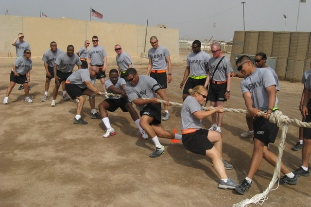 Contingency Operating Base Basrah, Iraq - Soldiers from 3rd Platoon, Alpha Distribution Company, 215th Brigade Support Battalion, 3rd Brigade Combat Team, 1st Cavalry Division, struggle to win the tug-of-war competition.  From left to right on the rope are:  Spc. Abel Morales, Staff Sgt. Jameel Hodges, 1st Lt. Michael Garland, Pfc. Nicole Veeser, and Pfc. Edgar Castellanos.