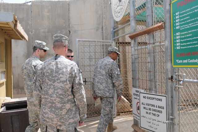 Maj. Gen. Adolph McQueen, deputy commanding general for detainee operations and provost marshal general of United States Forces - Iraq walks through the gates of the Karkh prison on Camp Croppe r, April 26.