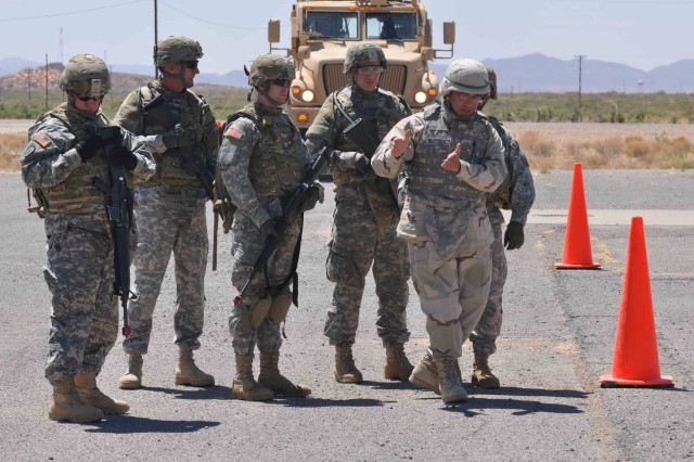 """Mr.  Phillip Ruiz, a technical instructor on the MRAP familiarization course, facilitated by 2nd Bn., 361st Regt., """"Coyote,"""" 5th Armored Bde., walks Soldiers from the U.S. Army Reserve's 236th Inland Cargo Transportation Company through the obstacle course at McGregor Range, N.M. May 2.  The one-day course is meant to familiarize Soldiers with the vehicle prior to deployment.  (Photo by Sgt. 1st Class Brian Scott, 5th Armored Brigade, Division West)"""