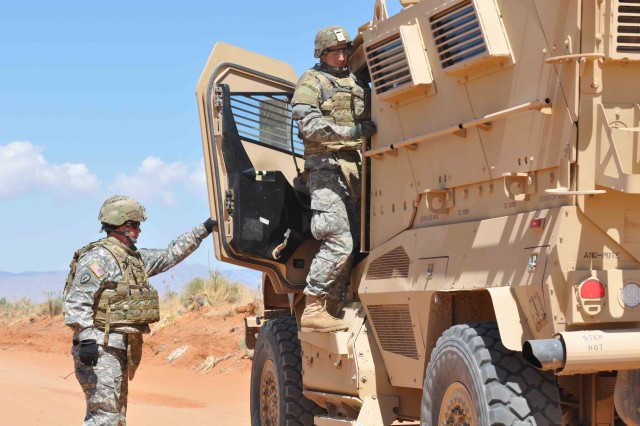 "Spc. Jamie Huling, left, and Spc. Daniel Boland, right, both of the 236th Inland Cargo Transportation Company, U.S. Army Reserve, switch out as drivers on the MRAP familiarization course at McGregor Range, N.M. May 2.  The one-day course, facilitated by 2nd Bn., 361st Regt., ""Coyote,"" 5th Armored Bde., is meant to familiarize Soldiers with the vehicle prior to deployment.  (Photo by Sgt. 1st Class Brian Scott, 5th Armored Brigade, Division West)"