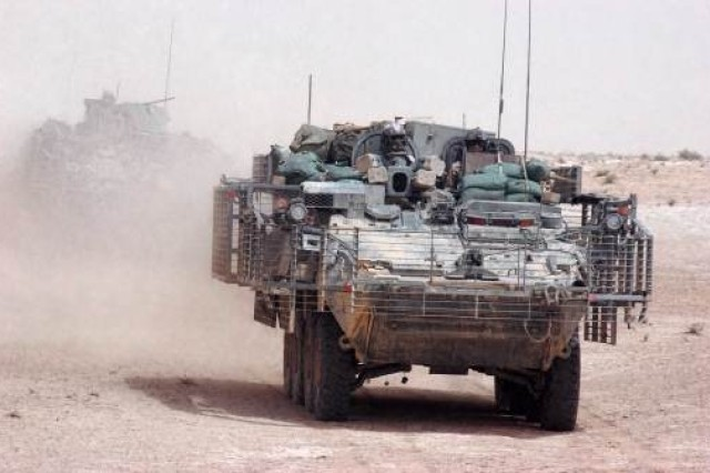 Stryker vehicles are shown maneuvering in the desert in May 2007. The armored wheeled vehicles are now being designed with a double-V hull for added protection from improvised explosive devices.