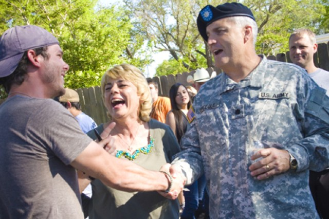 Lt. Col. Jim Speegle, III Corps, and his wife, Kay, meet Granger Smith April 28, 2011, at Legends Pub on Fort Hood, Texas. Speegle met Smith when he went to perform in Iraq in 2007.