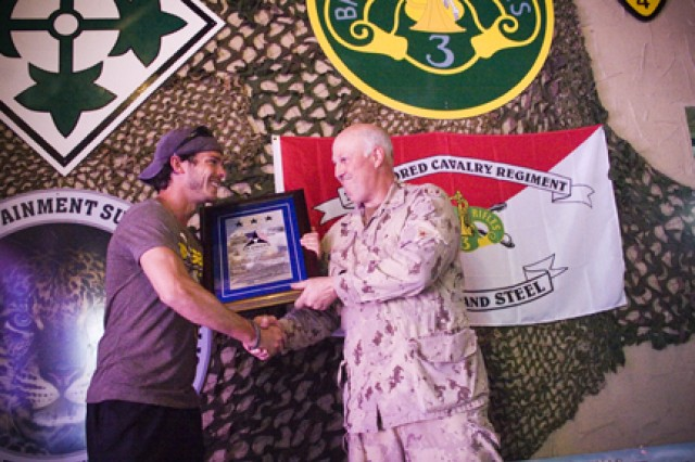 Country music singer Granger Smith is presented a plaque by Brig. Gen. Peter Atkinson, III Corps and Fort Hood deputy commanding general - Canada, April 28, 2011, in appreciation for all that Smith has done to support the military.