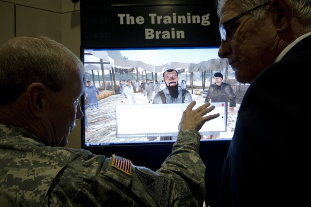 Gen. Martin E. Dempsey, then commanding general of the U.S. Army Training and Doctrine Command, now the Army's chief of staff, discusses the capabilities of remote training with Keith Johnston at the February 2011 Winter Association of the U.S. Army Exposition in Fort Lauderdale, Fla.