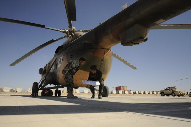 Afghan Air Force pilots conduct pre-flight checks on an Mi-17 helicopter being provided by the U.S. Departments of State and Defense. Plans call for acquiring 21 new Mi-17s. The aircraft caps at an altitude of 19,860 feet.