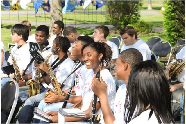 Musicians from the Edgewood High School Band relax before the start of APGAca,!a,,cs Arbor/Earth Day celebration April 29.