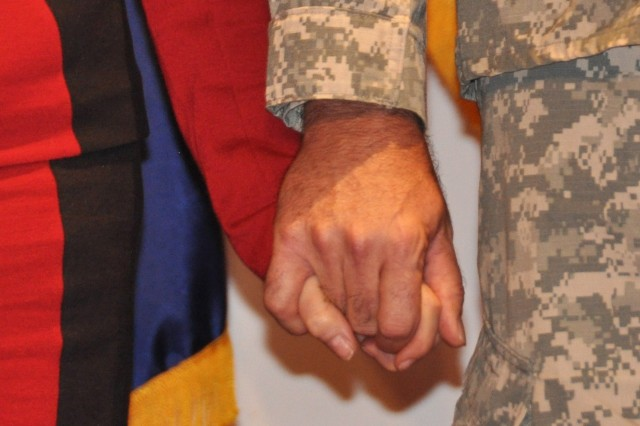 Lt. Gen. James H. Pillsbury, deputy commanding general of the U.S. Army Materiel Command and his wife, Becky, holding hands during Pillsbury's retirement ceremony Friday, May 6. U.S. Army Photo By Cherish Washington, AMC Public Affairs.