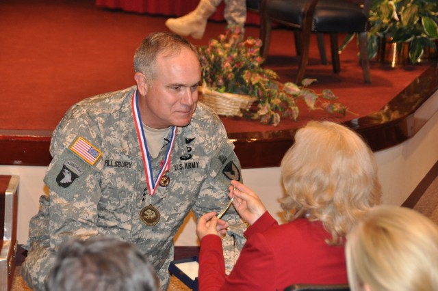 Lt. Gen. James H. Pillsbury, deputy commanding general of the U.S. Army Materiel Command and surprises his wife, Becky, with a diamond bracelet during Pillsbury's retirement speech Friday, May 6. U.S. Army Photo By Cherish Washington, AMC Public