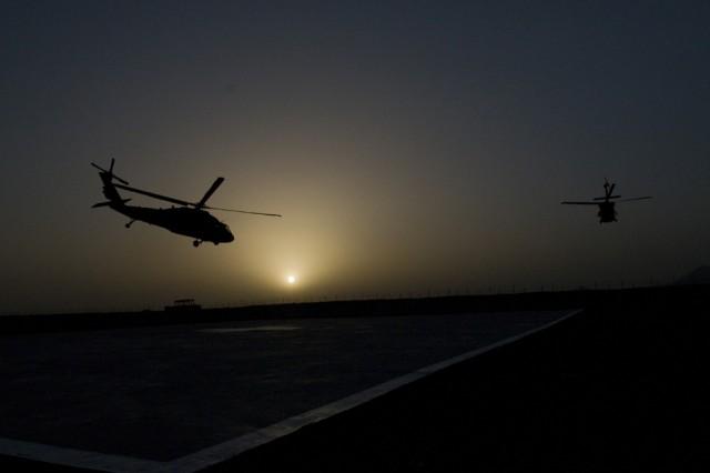 110505-F-8370-103 SPIN BOLDAK, Afghanistan-Two UH-60 Black Hawk helicopters depart Forward Operation Base Spin Boldak, Afghanistan, May 5, 2011.(Photo by Senior Airman Jessica Lockoski, 16th Mobile Public Affairs Detachment)