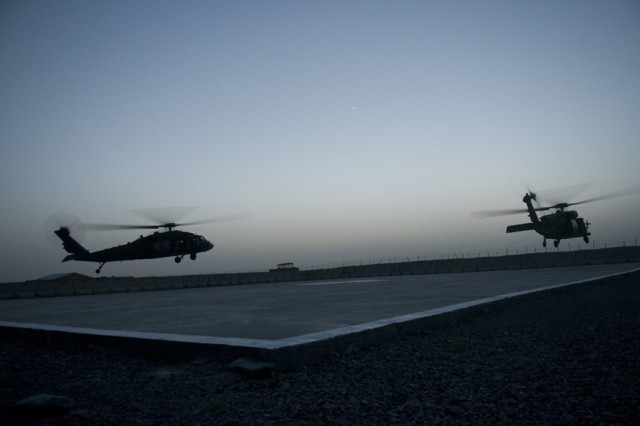 SPIN BOLDAK, Afghanistan-Two UH-60 Black Hawk helicopters hover over the landing pad at Forward Operating Base Spin Boldak, Afghanistan, May 5, 2011. (Photo by Senior Airman Jessica Lockoski, 16th Mobile Public Affairs Detachment)
