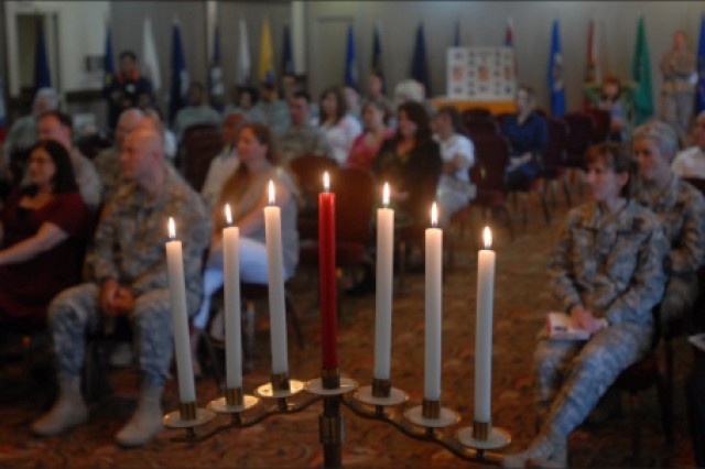 Attendees listen to guest speakers at the Days of Remembrance ceremony May 4 at Camp Walker's Evergreen Community Club after the lighting of the seven candles.