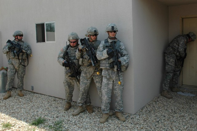 Squad stacked at door