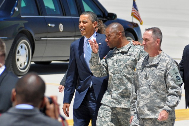 President Barack Obama is escorted by Maj. Gen. Dana J.H. Pittard, Fort Bliss commanding general, and Command Sgt. Maj. David Davenport, to a motorcade that took him to speak at the Chamizal National Memorial in El Paso, Texas, May 10, 2011.